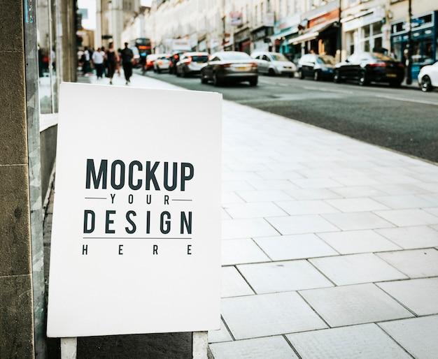 Mockup-poster aan de buitenkant van een winkel Gratis Psd