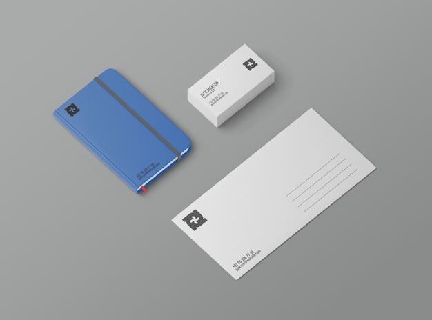 Mockup stazionario con biglietto da visita, quaderno e cartolina Psd Premium