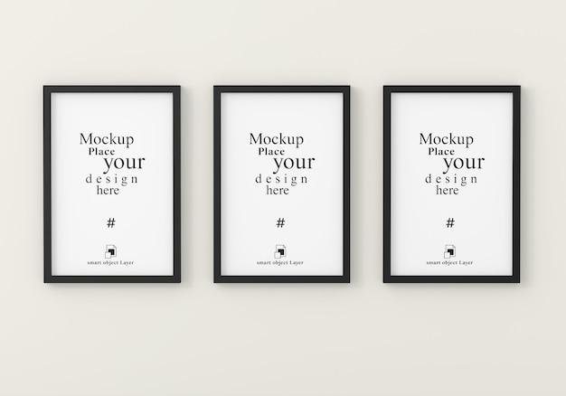 Mockup tre cornici vuote per mockup nella stanza bianca vuota Psd Premium