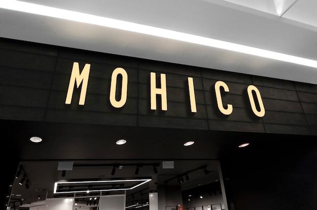 Mockup van neon 3d logo teken in perspectief op de ingang van de winkel Premium Psd