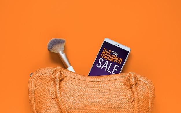 Mockup van smartphone met handtas en make-up kwast Premium Psd