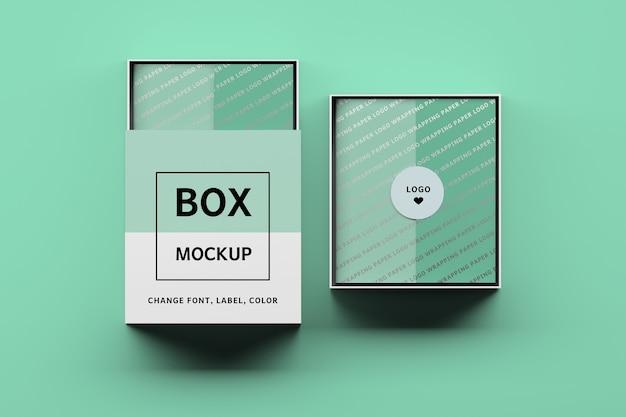 Mockup van twee dozen met bewerkbare labels en inpakpapier Premium Psd