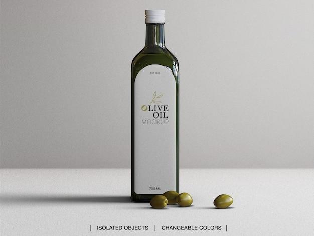 Mockup van vooraanzicht olijfolie glazen fles met olijven Premium Psd