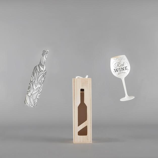 Model met wijnfles met doos en glas Gratis Psd