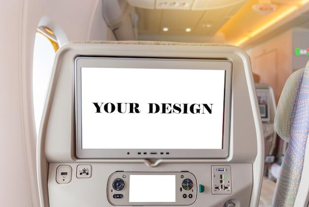 Model van vliegtuigenmonitor op cabine in het vliegtuigbinnenland van de passagierszetel Premium Psd