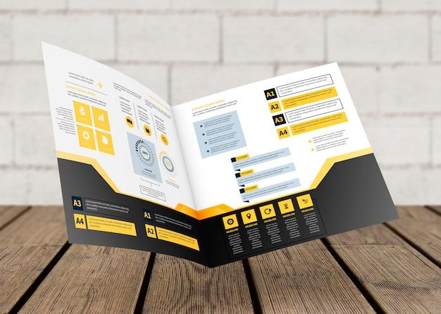 Modello di brochure quadrato galleggiante sopra la superficie in legno Psd Gratuite