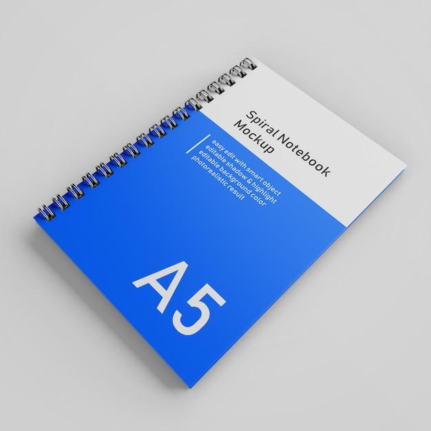 Modello di disegno realistico del modello del taccuino del taccuino del raccoglitore a spirale della copertina rigida del singolo ufficio a5 nella vista di prospettiva superiore Psd Premium