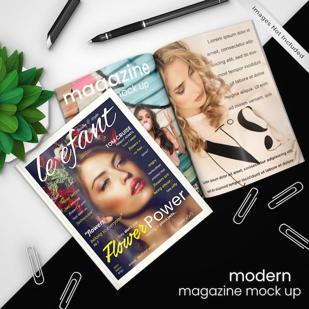 Modello di mockup di rivista creativa, moderna di due riviste sul design moderno in bianco e nero con clip di carta, penna e pianta verde, psd mock up Psd Premium