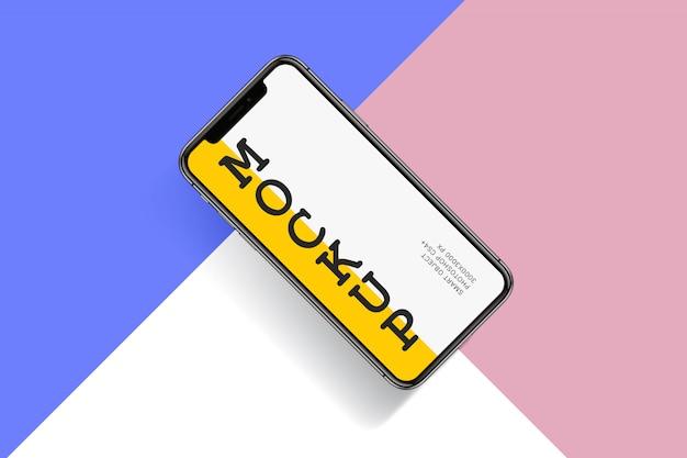 Modello di smartphone su sfondo colorato Psd Premium