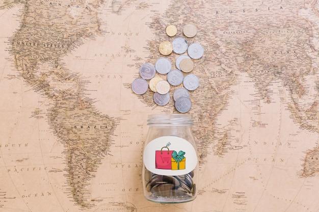 Monete sulla mappa del mondo Psd Gratuite