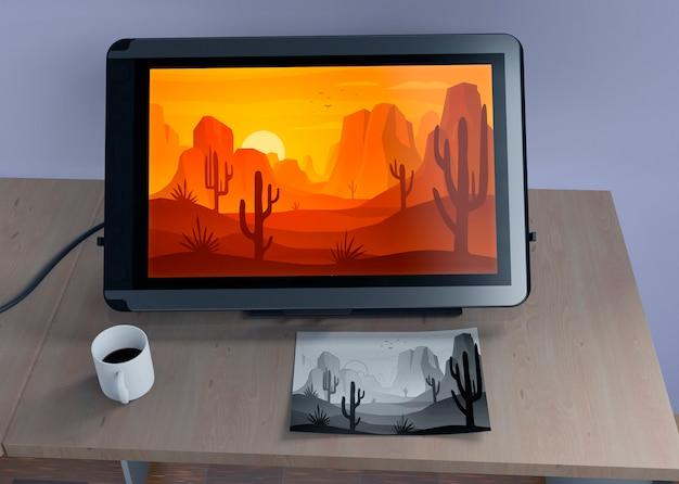 Monitor met natuurlandschap en schets Gratis Psd