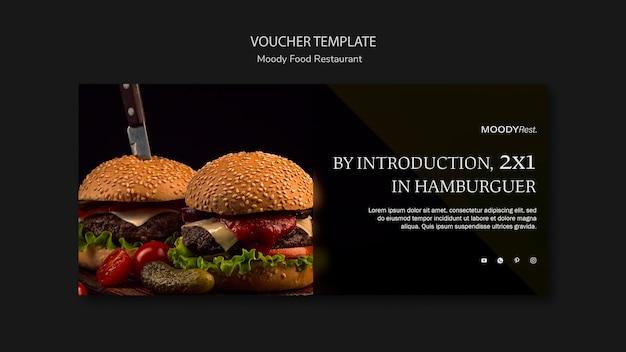 Moody eten restaurant voucher sjabloon met hamburgers Gratis Psd