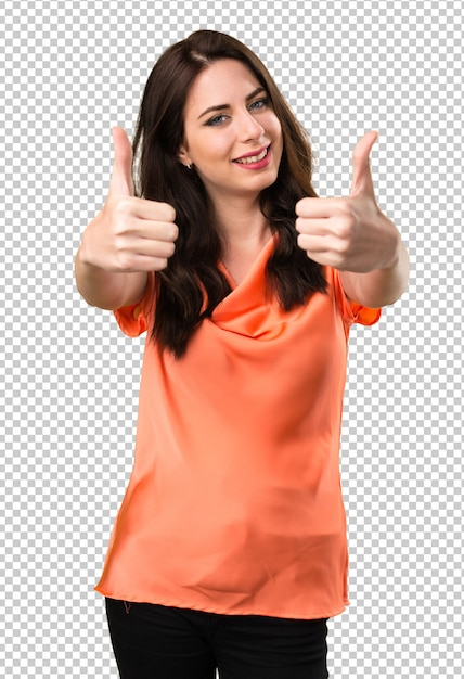 Mooi jong meisje met duim omhoog Premium Psd