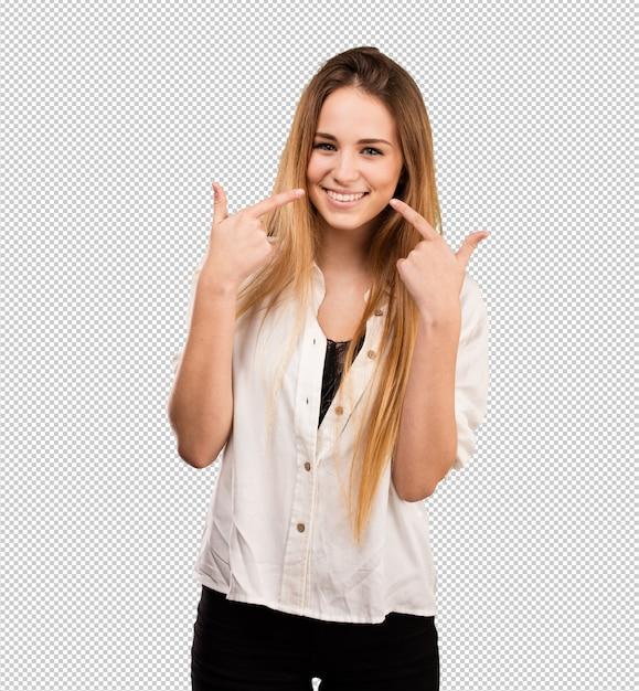 Mujer bastante joven que señala su boca PSD Premium