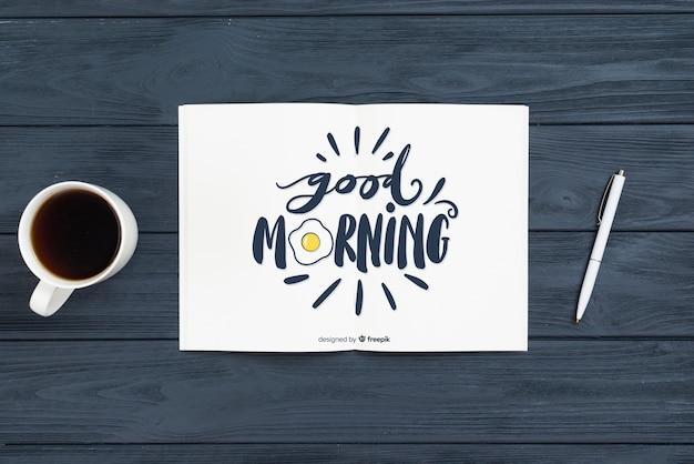 Notebook en pen ochtend concept Gratis Psd