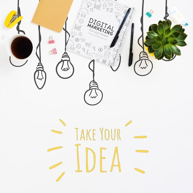 Notebook en pennen idee concept Gratis Psd