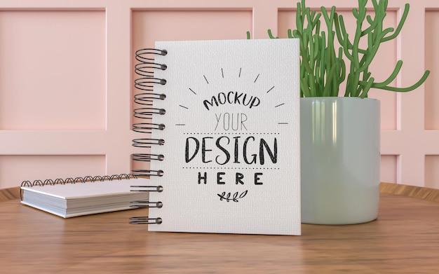 Notebook con espacio de trabajo mockup PSD gratuito