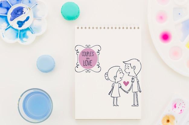 Notitieboekje met paar in liefdetekening Gratis Psd