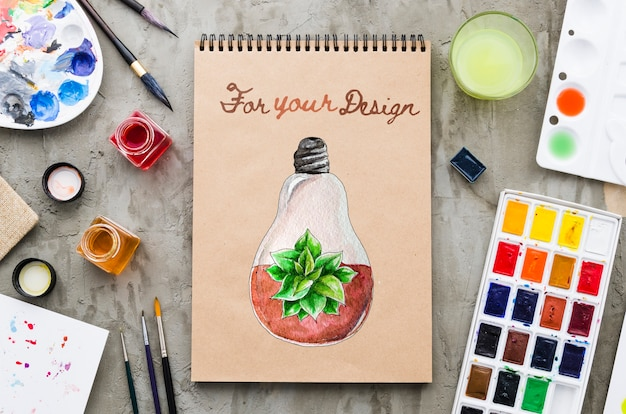 Notitieboekje met realistische en kleurrijke tekening Gratis Psd