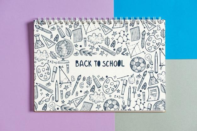 Notitieboekjemodel met terug naar schoolconcept Gratis Psd
