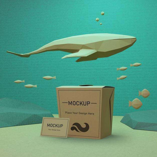 Oceaan dag papieren zak concept met dolfijn Gratis Psd