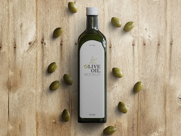Olijfolie glazen fles mockup met verspreide olijven op houten tafel Premium Psd