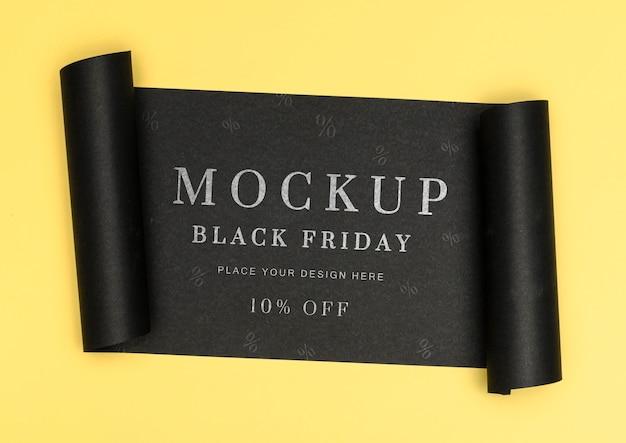 Opgerolde banner van gele achtergrond zwarte vrijdag verkoop mock-up Gratis Psd