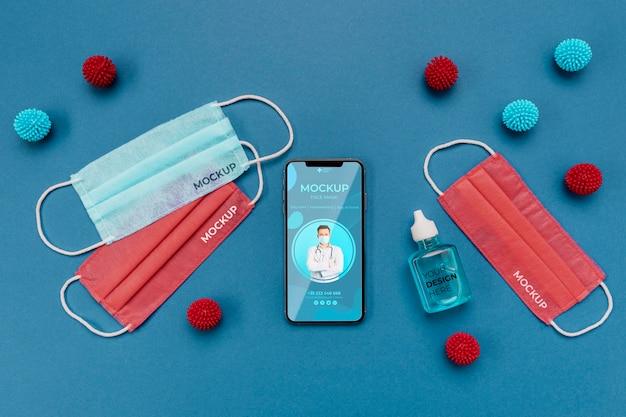 Opstelling van coronavirus-elementen met smartphonemodel Gratis Psd