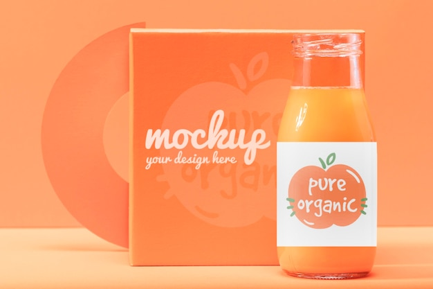 Oranje smoothie mock-up design Gratis Psd