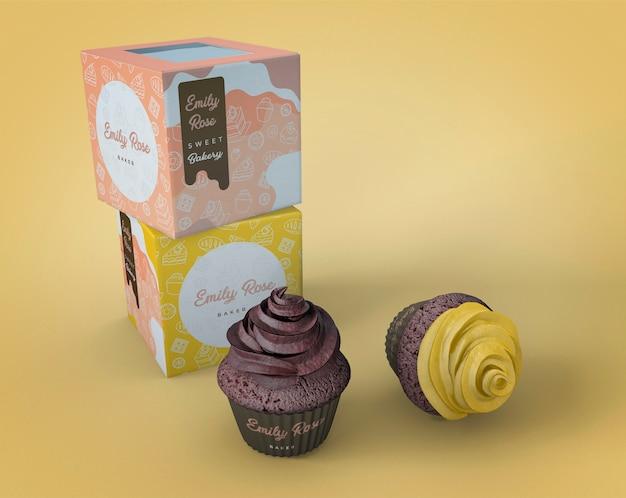 Packaging per cupcake e mockup di branding Psd Gratuite