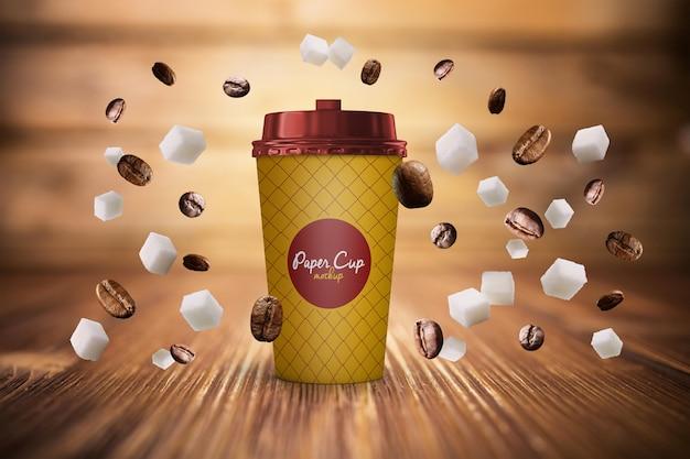 Papieren koffiekopje en bonen in zwaartekrachtmodel gratis psd Premium Psd