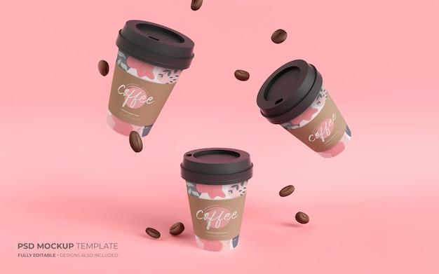 Papieren koffiekopjes en bonen in zwaartekrachtmodel Gratis Psd