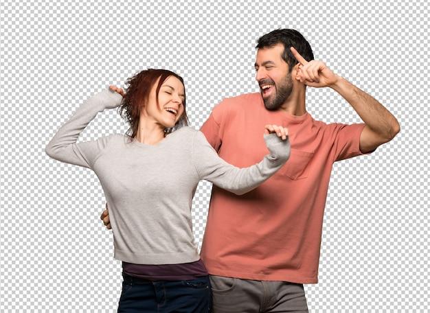 Pareja en el día de san valentín disfruta de bailar mientras escucha música en una fiesta PSD Premium