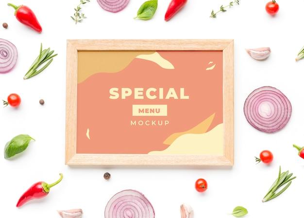 Pastelkleurig frame met arrangement van groenten Gratis Psd