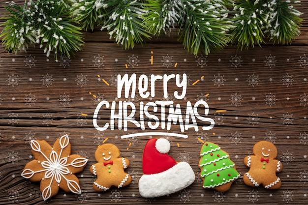 Peperkoek bovenaanzicht en kerst pijnboombladeren Gratis Psd