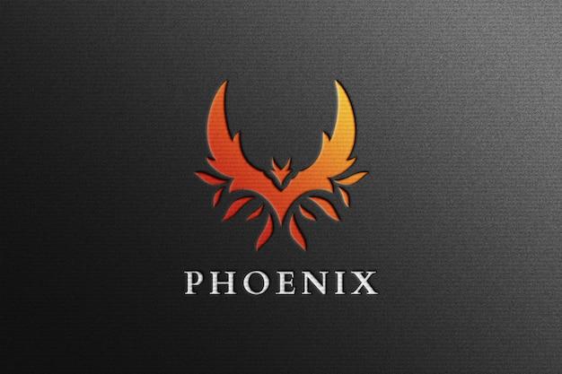 Phoenix logo mockup in zwart geperst papier Premium Psd