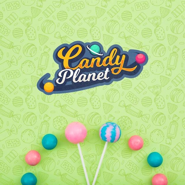 Planeta de caramelo y surtido de piruletas PSD gratuito