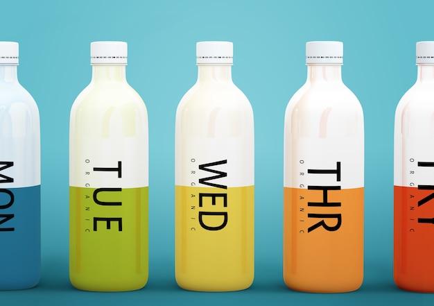 Plastic flessen met verschillende soorten fruit of groentesappen voor elke dag van de week Gratis Psd