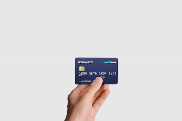 Plastic kaart in de hand mockup Premium Psd