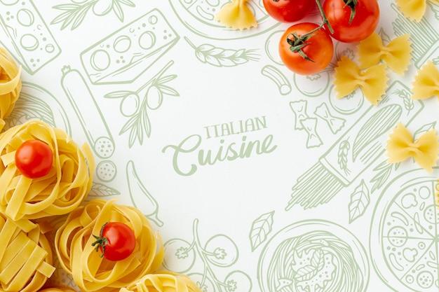 Plat lag ongekookte tagliatelle en tomaten met hand getrokken achtergrond Gratis Psd