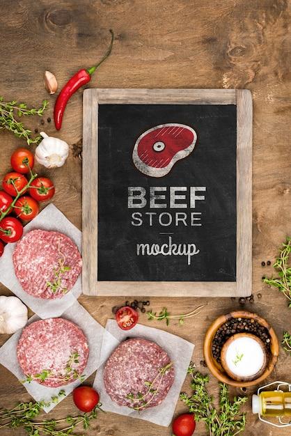 Plat lag slagerij met hamburgersvlees Gratis Psd