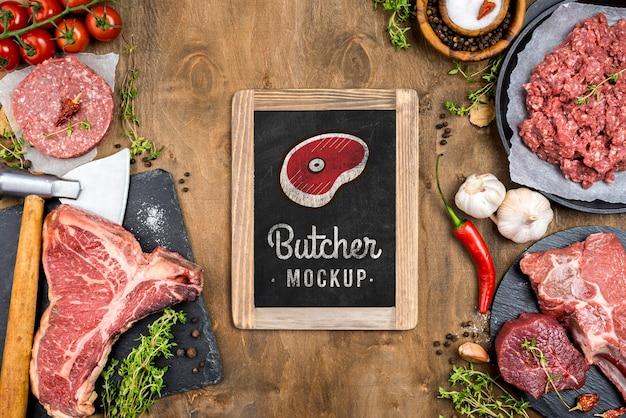 Plat lag slagerij met vers vlees Gratis Psd