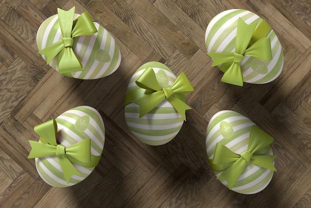 Plat leggen eieren verpakt voor paasviering Gratis Psd