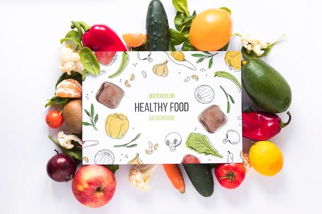 Plat leggen van gezond voedsel met kaartmodel Gratis Psd