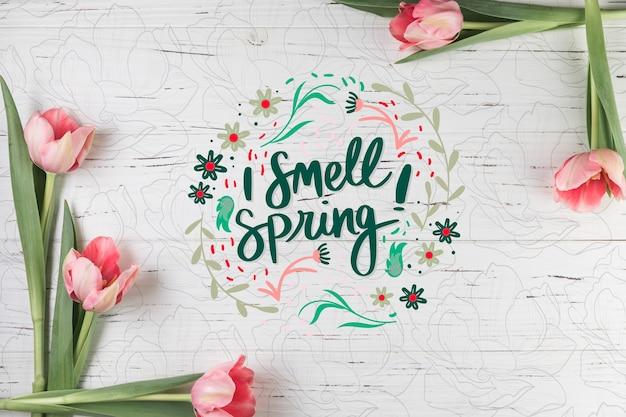 Plat leggen voorjaar mockup met copyspace en frame Gratis Psd