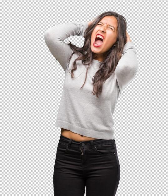 Portret van jonge indiase vrouw gek en wanhopig, schreeuwen uit de hand Premium Psd