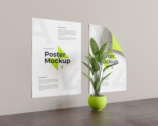 Poster mockup met plant in het midden kijk in de linker weergave Premium Psd