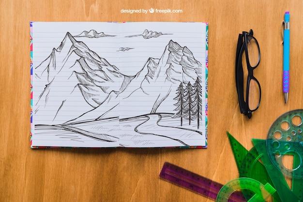 Potlood tekening van bergen met bril, pen en rechte randen Gratis Psd