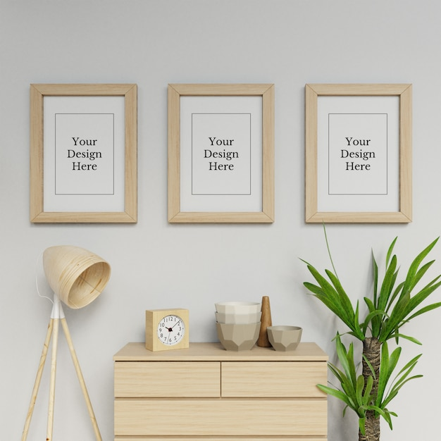 Premium triple a2 poster frame mock up ontwerpsjabloon opknoping portret in interieur Premium Psd