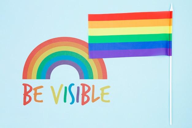 Priorità bassa di gay pride con la bandiera arcobaleno Psd Gratuite